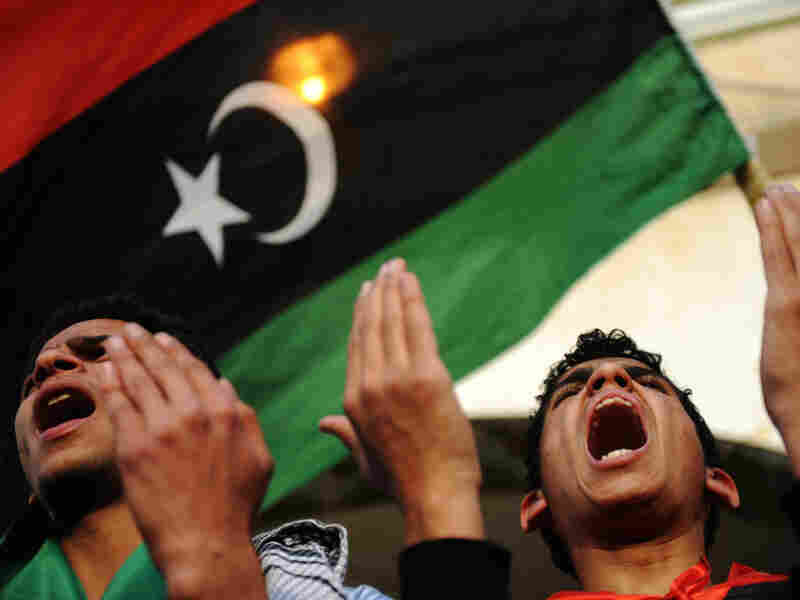Libyan anti-government protesters pray at the end of a small demonstration in the eastern Libyan city of Tobruk as Moammar Gadhafi's forces bombarded rebel positions on the doorstep of Ajdabiya. On Thursday, the U.N. voted for a no-fly zone over Libya.