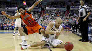 Benjamin Stewart #23 of the Connecticut Huskies fights for a loose ball with Bryson Johnson #12 of the Bucknell Bison on March 17, 2011 in Washington, DC.