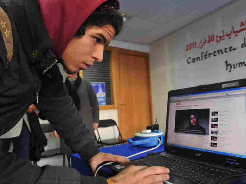 A young Moroccan watches a video on Feb. 17, calling for demonstrations. Three days later, the demonstration organized by a coalition of groups took place in cities throughout the country. U.S. intelligence officials say that in hindsight, using open sources like Facebook and Twitter could have helped them predict the uprisings that have swept the Arab world.