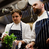 Todd Woods and his sous chefs prepare baby greens for a quick saute at Restaurant Nora in Washington, D.C.