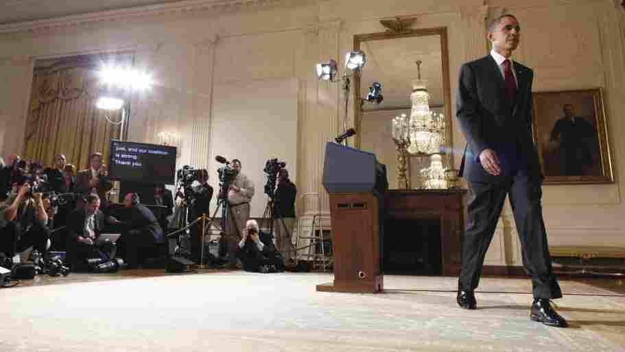 President Obama leaves after making a statement on Libya, Friday, March 18, 2011.