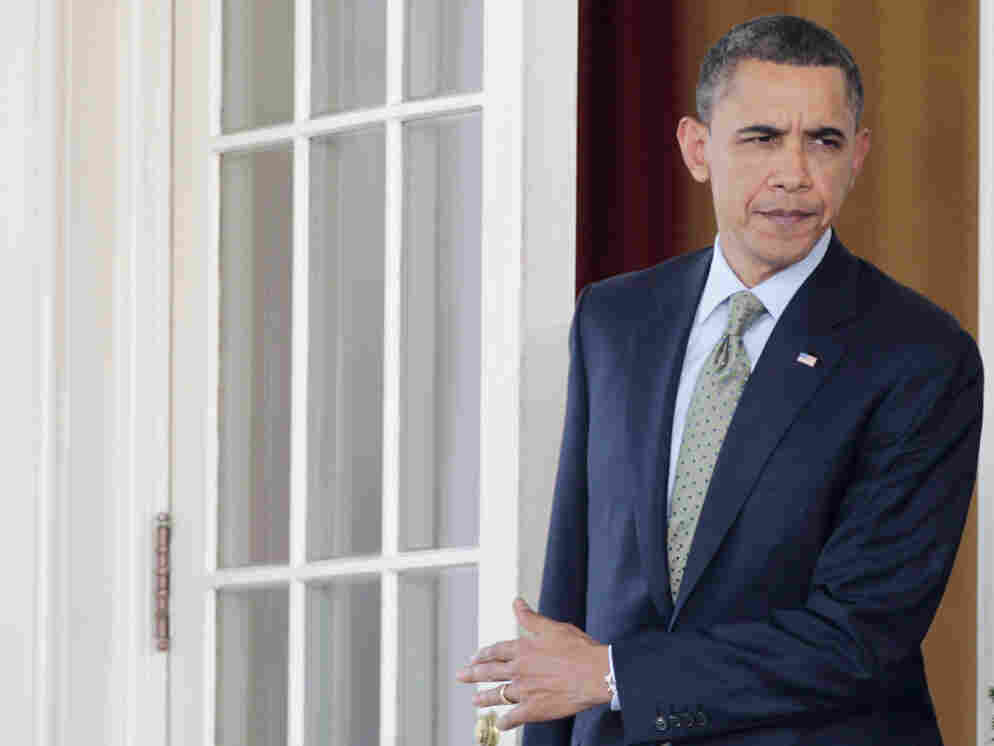 President Barack Obama walks out of the Oval Office, March, 17, 2011.