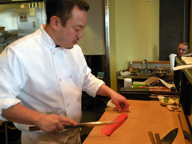 Taichi Kitamura prepares sushi in his restaurant Sushi Kappo Tamura in   Seattle. Kitamura is concerned that public fears about radiation from  Japan's disabled nuclear power plant  could  scare customers away.