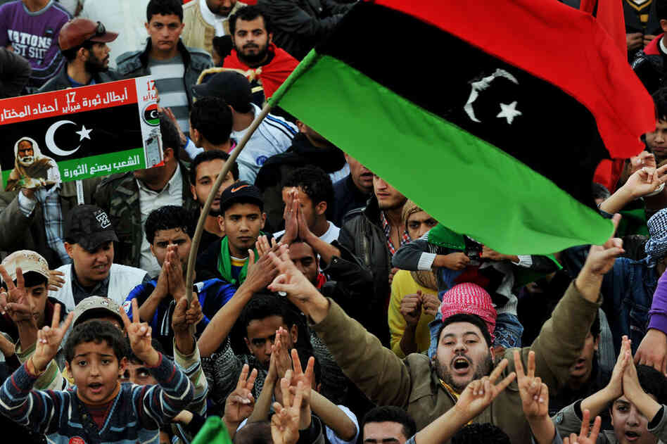 Libyan anti-government protesters chant slogans and wave the revolution flag in the city of Tobruk on Friday as thousands gathered for prayers and celebrations.
