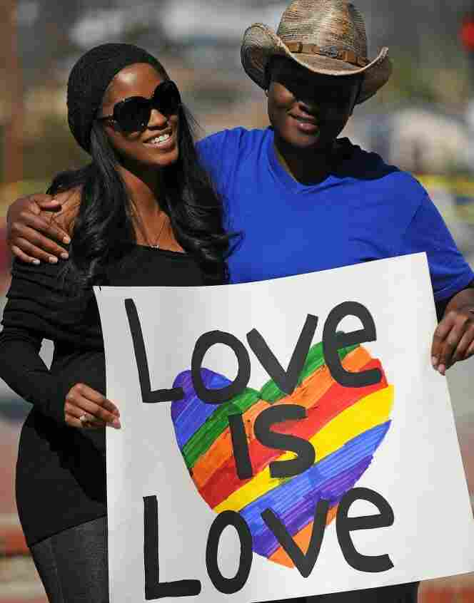 A lesbian couple hold a sign at a protest calling for the right for gays and lesbians to marry outside the County Clerk s Office in Los Angeles on Valentine's Day, 2011.