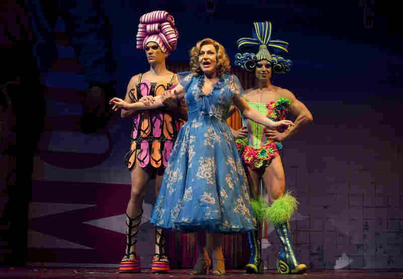 Mitzi (Will Swenson), Bernadette (Tony Sheldon) and Felicia (Nick Adams) cross the Australian outback in a tour bus named Priscilla in Priscilla Queen of the Desert. Inspired by a 1994 movie of the same name, the Broadway musical reinvents some of the film's iconic costumes, like the flip-flop dress worn by Swenson (left). The show features 500 costumes made by 18 production houses aroun...