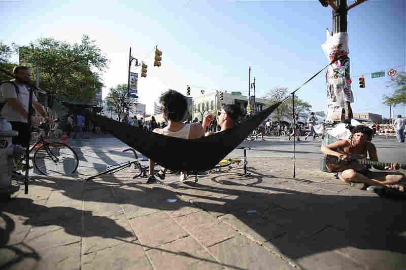 Some Austinites get crafty with a makeshift hammock.