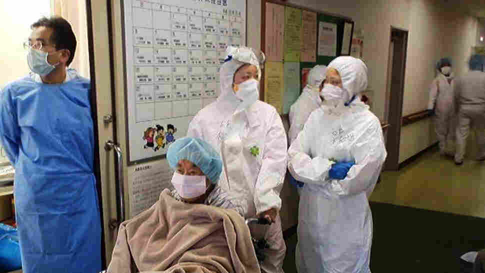 Nurses wear radiation protection suits at a hospital in Minamisoma city in Fukushima prefecture on March 16.