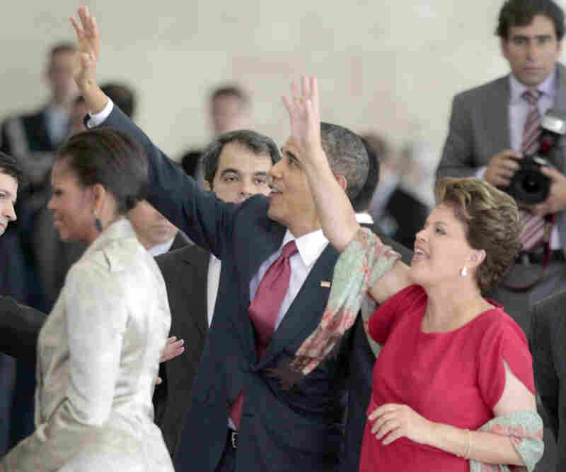President Obama, center, and Brazilian President Dilma Vana Rousseff, right, wave to greeters on the balcony during the arrival ceremony  at the Palacio do Planalto in Brasilia, Brazil, on March 19.