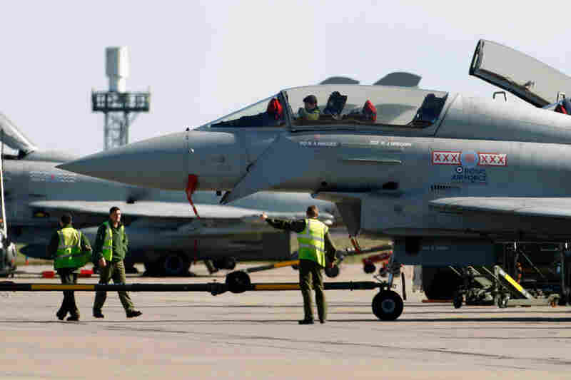 The Royal Air Force was preparing Friday to help enforce a no-fly zone over Libya. Above, Typhoon Eurofighters in Coningsby, England.