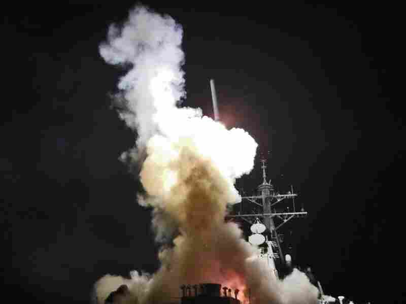 The Arleigh Burke-class guided-missile destroyer USS Barry launches a Tomahawk missile from the Mediterranean Sea toward the Libyan coast on Saturday. The missiles targeted Moammar Gadhafi's radar and missile sites, to pave the way for a no-fly zone authorized by the U.N.