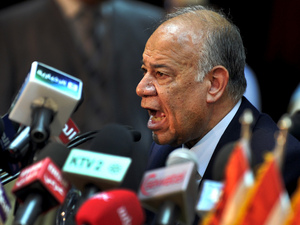 Mohammed Attiya, chief of Egypt's elections commission, announces the results of the referendum  Sunday.