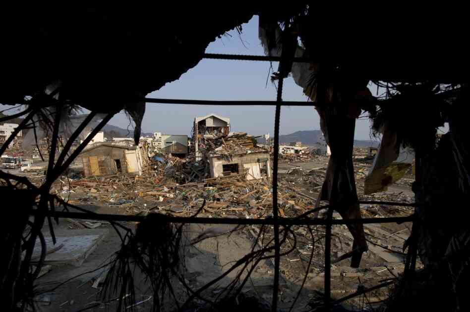 Destroyed buildings are seen though the rubble in the northern town of Rikuzentakata on March 19.