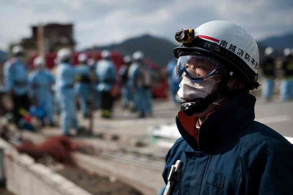 A member of a Japanese rescue team takes part in operations in Rikuzentakata.