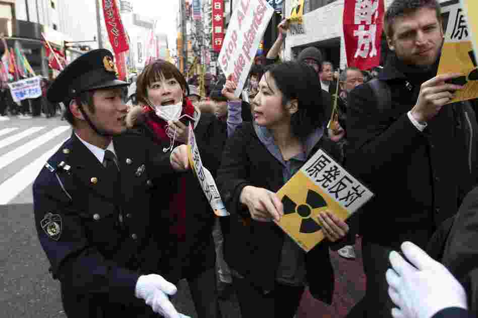 People confront police during an anti-war and anti-nuclear march in Tokyo. Hundreds of protesters marched for peace and against nuclear power, as plant workers continue their race to avert disaster at the tsunami-damaged Fukushima Dai-ichi nuclear power plant in the north.