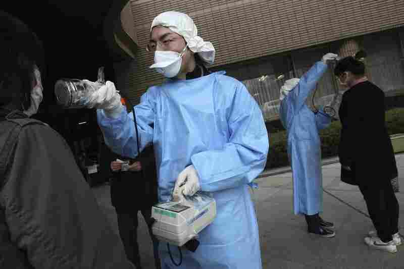 Women are screened for radiation exposure at an evacuation center in Fukushima, Fukushima prefecture.