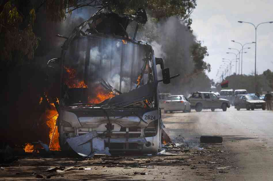 A bus burns on a road in the outskirts of Benghazi.
