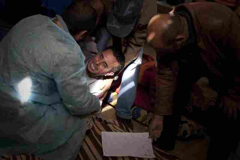 A Libyan man reacts after identifying his brother at the morgue in Jalaa hospital in Benghazi.