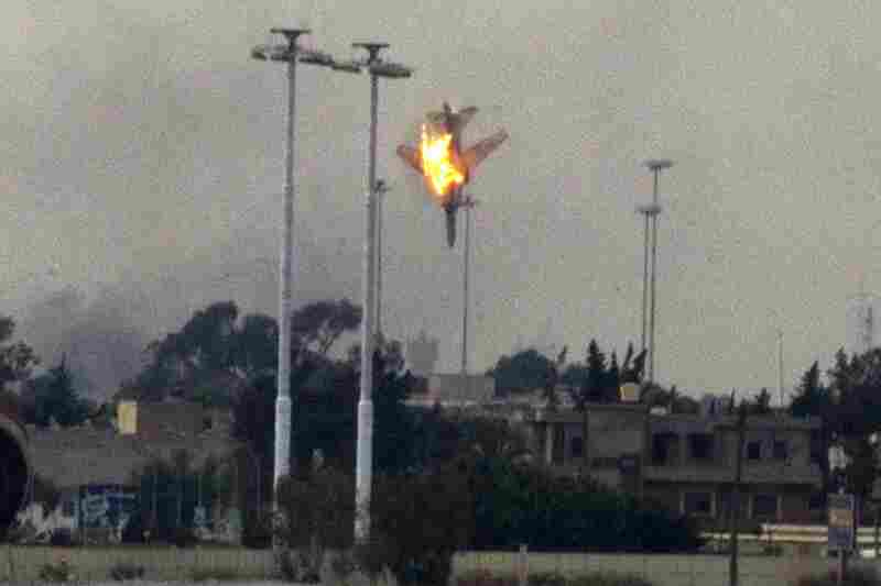 A plane is shot down over the outskirts of Benghazi.