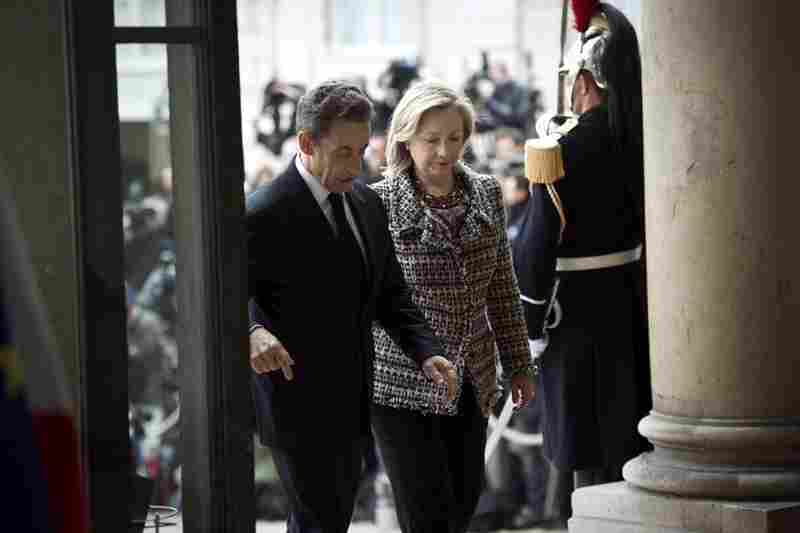 U.S. Secretary of State Hillary Clinton arrives with French President Nicolas Sarkozy at the Elysee Palace in Paris before a summit on implementing the U.N. Security Council resolution authorizing military action in Libya.