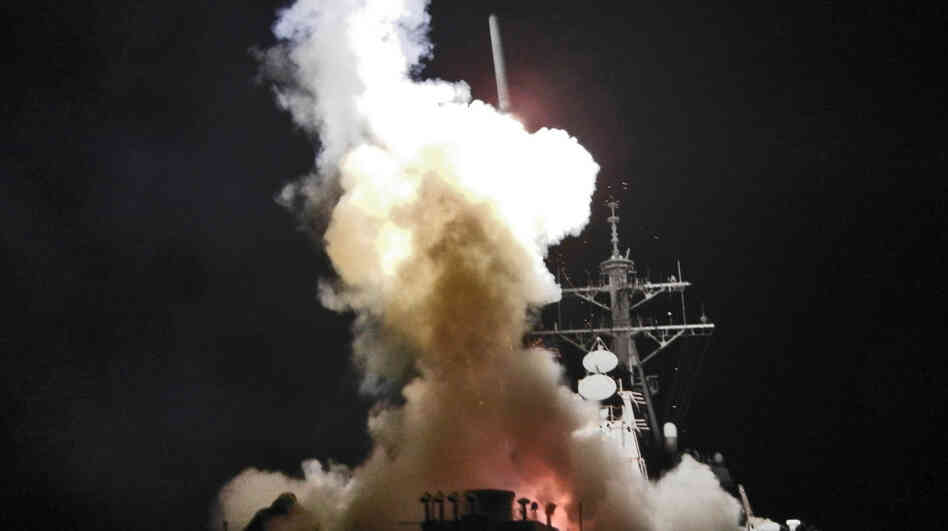 The USS Barry launches a Tomahawk missile in support of Operation Odyssey Dawn. This was one of approximately 110 cruise missiles fired from U.S. and British ships and submarines targetting about 20 radar and anti-aircraft sites along Libya's Mediterranean coast.