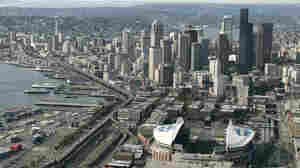 The Alaskan Way Viaduct, the raised two-level highway that runs along Seattle's downtown waterfront, is seen from the air in 2006. Seattle is now replacing it to improve mobility for people and goods.