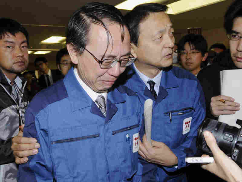 Tokyo Electric Power Co.'s managing director, Akio Komori (left), cries as he leaves a press conference in Fukushima on Friday. The company has apologized for its handling of the nuclear crisis, but calls are growing for more monitoring and accountability of TEPCO and other large companies.