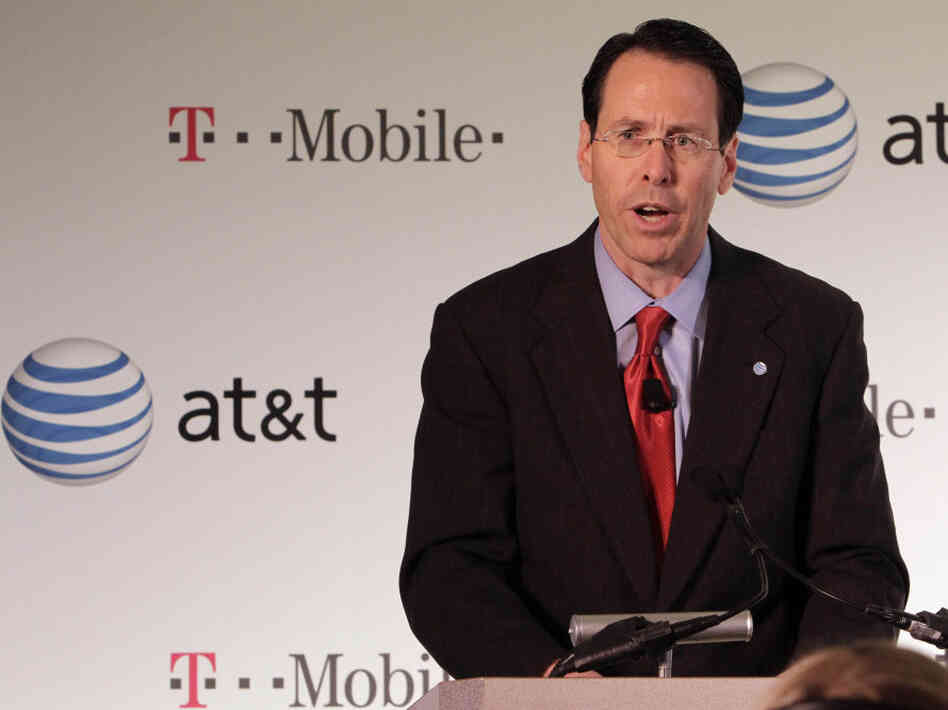 AT&T CEO Randall Stephenson announces the company's decision to buy T-Mobile USA from Deutsche Telekom in New York on Monday.