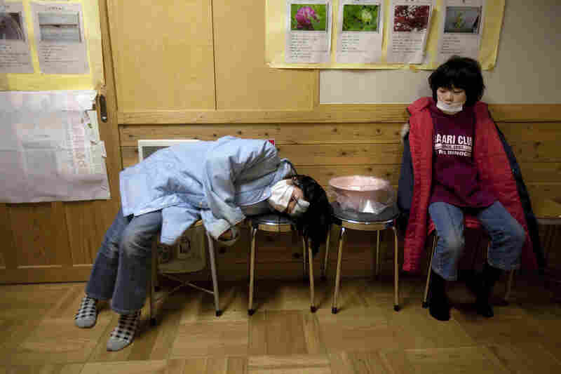 Japanese refugee children wait for medical treatment inside a shelter in Rikuzentakata.