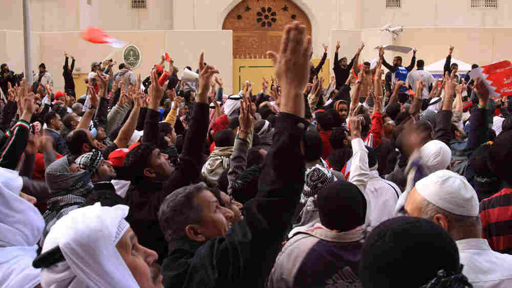 Anti-government protesters demonstrate in front of the Saudi Embassy in Manama, Bahrain, on March 15.  Frenzied clashes swept Bahrain a day after a Saudi-led military force entered the country to help defend the Sunni monarchy from a Shiite-led protest movement.
