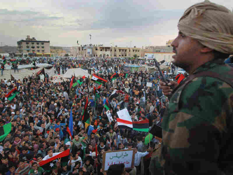 Rebel supporters gathering during a celebratory rally in Tobruk, Libya after the United Nations approved a no-fly zone over the country on Thursday. In the past several weeks, some experts have been split on how, if at all, the U.S. should intervene.