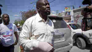 With a bandage in his right hand, Haitian-American singer Wyclef Jean, leaves a polling station after casting his ballot during a presidential runoff in Port-au-Prince, Haiti.