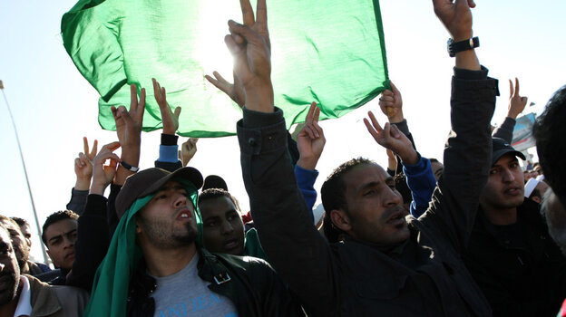 Men in Tripoli join in the part-protest, part-funeral for civilians said to have died during recent airstrikes in Libya. They gathered at a place along Libya's Mediterranean coast known as a cemetery for martyrs.