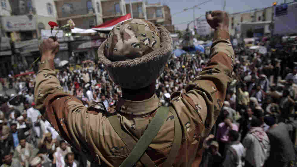 In Sanaa today, a Yemeni army officer reacts  after he and other officers joined anti-government protesters demanding the resignation of President Ali Abdullah Saleh.