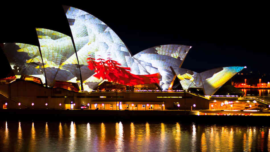 Projections on the giant sails of the Sydney Opera House, which served as the venue for the YouTube Symphony Orchestra concert.