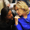 """Secretary of State Hillary Clinton (right) talks with Susan Rice, the U.S. ambassador to the United Nations, in September. The two played a critical role in winning U.N. authorization of using """"all means necessary"""" to protect civilians in Libya."""
