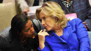 "Secretary of State Hillary Clinton (right) talks with Susan Rice, the U.S. ambassador to the United Nations, in September. The two played a critical role in winning U.N. authorization of using ""all means necessary"" to protect civilians in Libya."
