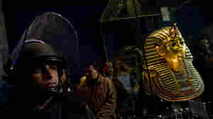 A soldier stands guard next to Tutankhamen's gold mask inside the Egyptian Museum on Feb. 16. Looters broke into the museum in Cairo's Tahrir Square in late January.