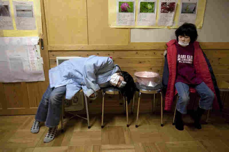 Japanese refugee children wait for medical treatment inside a shelter in Rikuzentakata.