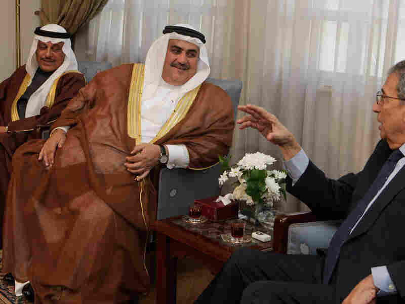 Amr Moussa, secretary-general of the Arab League (right), meets with Bahraini Foreign Minister Sheikh Khaled bin Ahmed al-Khalifa at the Arab League headquarters in Cairo on Tuesday.