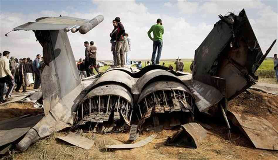 Libyans inspect the wreckage of a US  F-15 fighter jet after it crashed east of Benghazi, Libya, Tuesday, March 22, 2011.