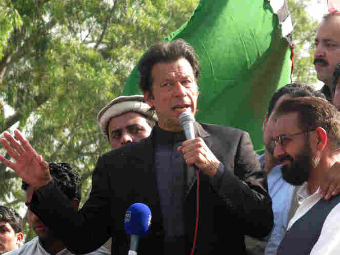 Cricket-player-turned-politician Imran Khan speaks to a large demonstration in Islamabad.