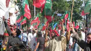 Hundreds protest in Islamabad, waving the flags o