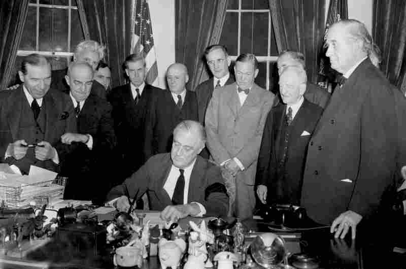 President Franklin Roosevelt signs the declaration of war against Japan on Dec. 8, 1941, following the bombing of Pearl Harbor.