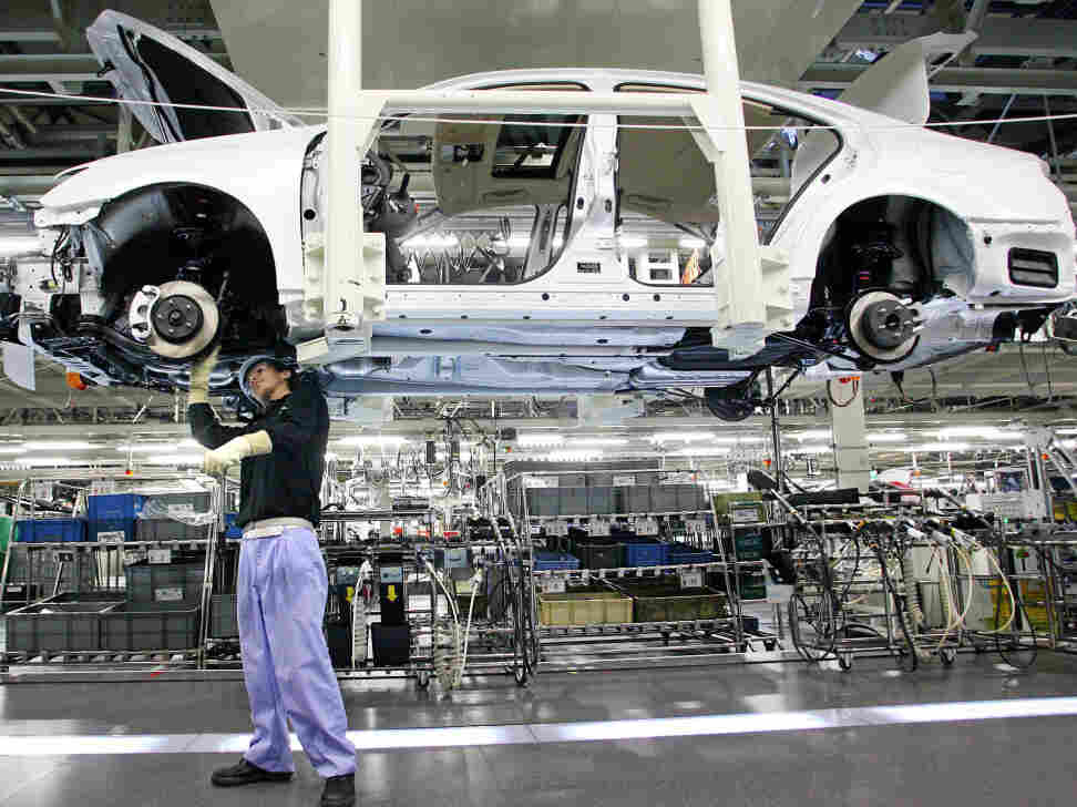 A worker assembles a Lexus car at the Toyota's plant in Miyata City, Fukuoka Prefecture on October 2, 2006.