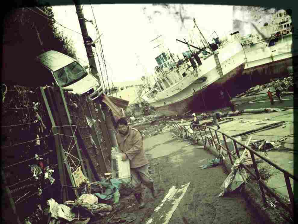 A man walks up from the port of Kesennuma, Japan.