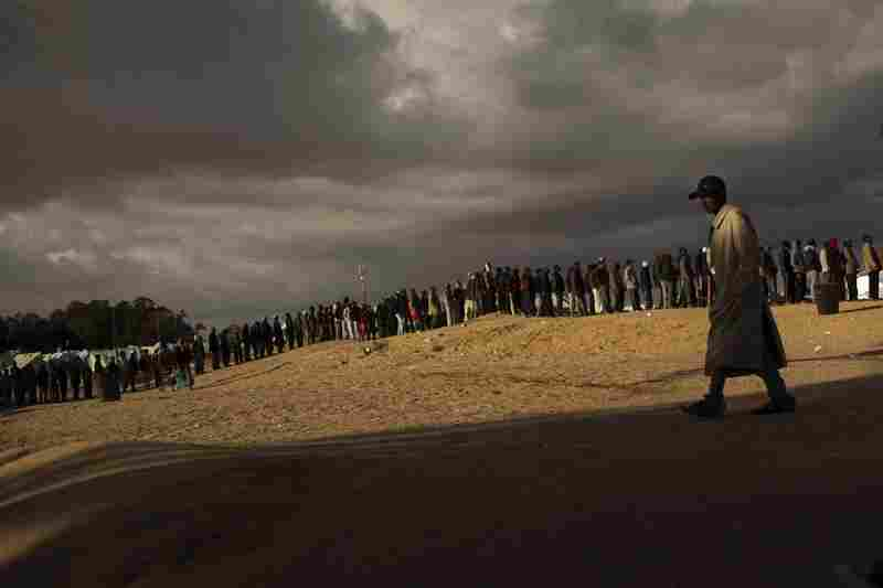 Men who used to work in Libya and fled the unrest in the country line up as they wait for food in a refugee camp in Ras Ajdir, Tunisia, on the Libyan border.
