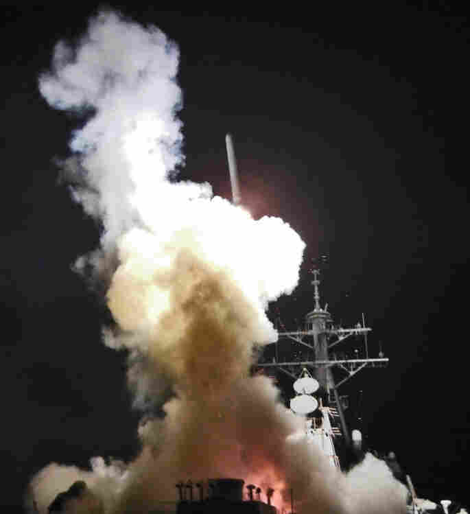 The USS Barry launches a Tomahawk cruise missile Saturday in support of Operation Odyssey Dawn. The operation targeted radar and anti-aircraft sites along Libya's Mediterranean coast.