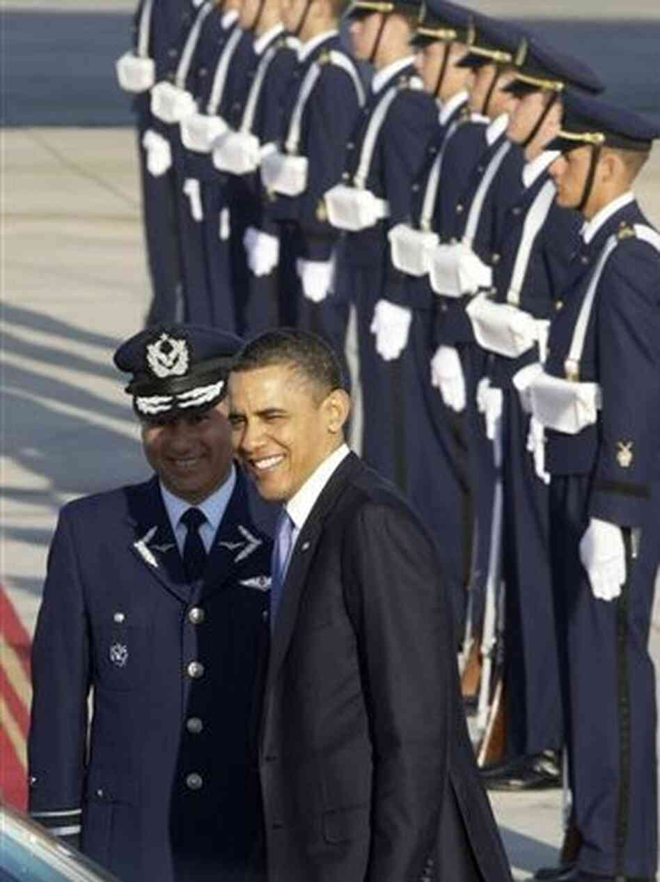 President Obama poses with Chilean Air Force officer before leaving Santiago, Chile, Tuesday, March 22, 2011.