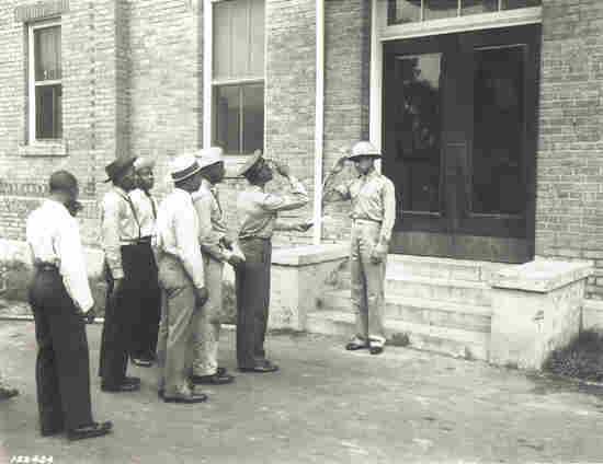 A group of  recruits for the 99th Pursuit Squadron reports to Captain Benjamin O. Davis  Jr., commandant of cadets at Tuskegee Army Air Field in  Alabama, September 1941.